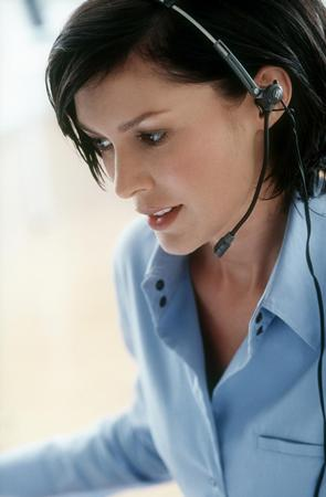 copy of iStock 000004108355XLarge Girl in Headset